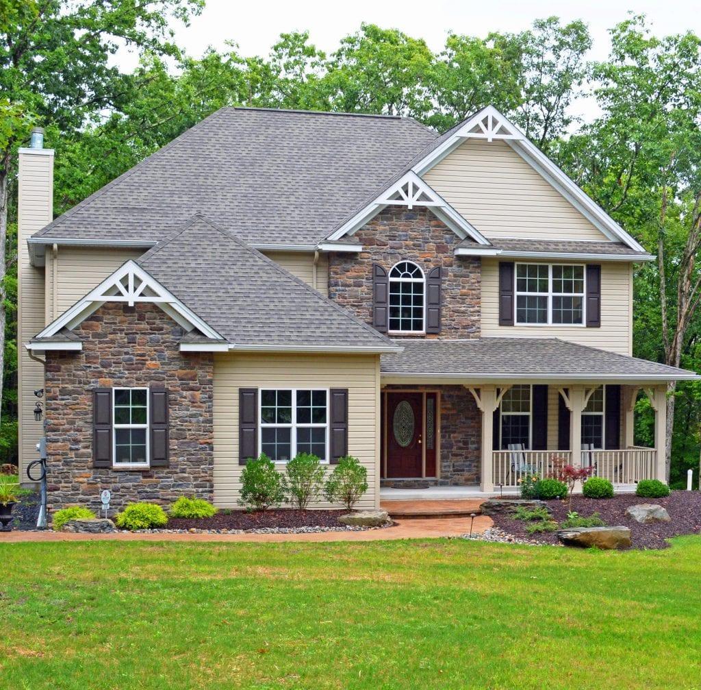 Pocono home exterior with plants and stone siding