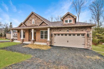 Custom ranch home exterior, 4 pillars at entrance, 2-car garage