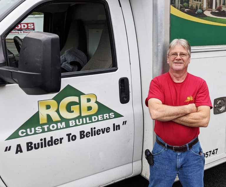 Photo of Phil next to RGB truck