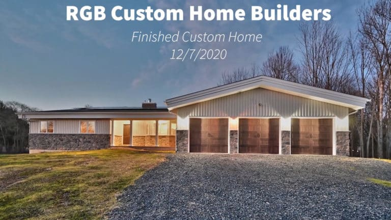 RGB Custom Home Exterior, single story home with 3-car garage and solar array on roof