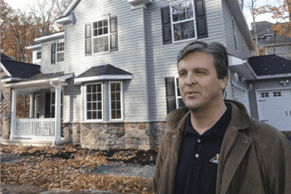Bob standing in front of award-winning home