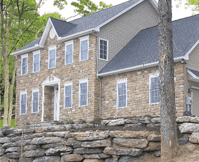 Emerald Award-winning home built by RGB with light brown stone siding